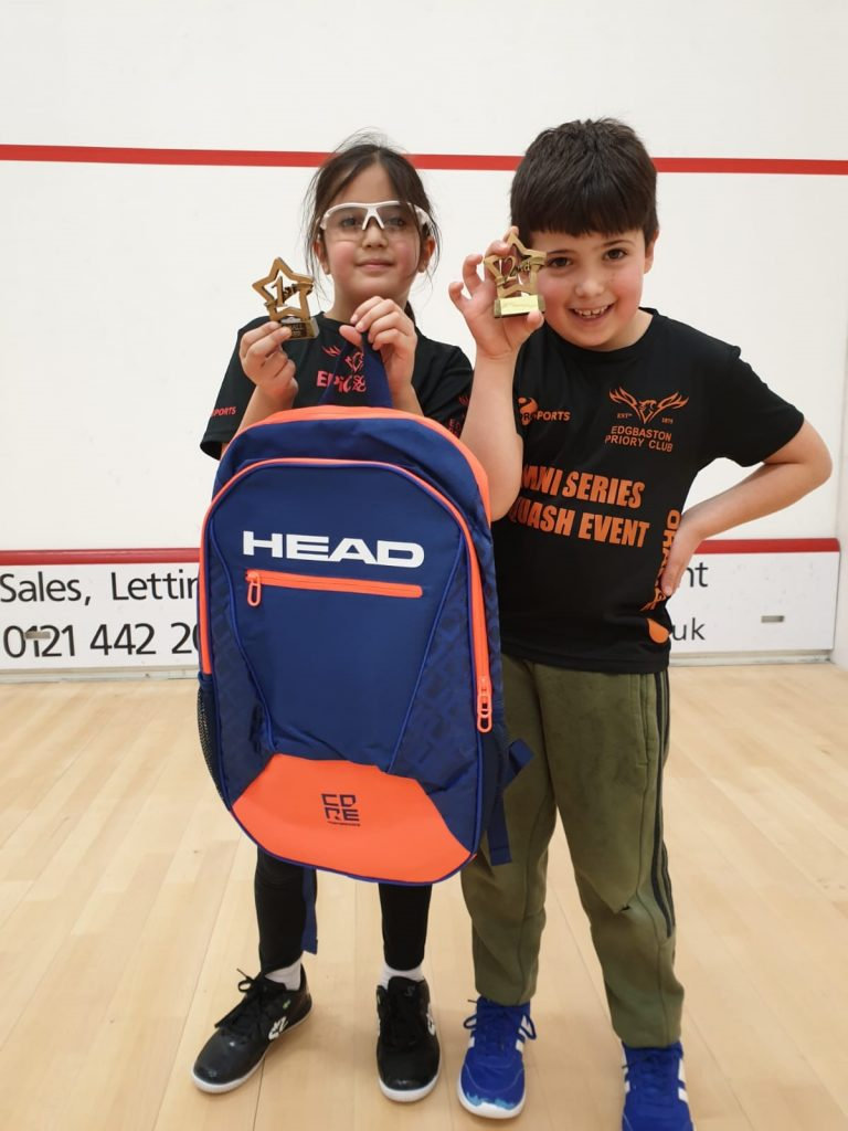 Boy and Girl champions of Squash tournament.