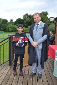 Large Image of year 6 pupil and Headteacher at Hallfield School All day Cup event.