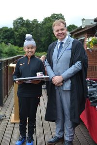 Large Image of year 6 pupil and Headteacher at Hallfield School.