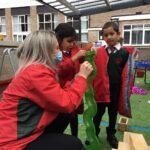 Image of Reception at Hallfield School learning about water flow.