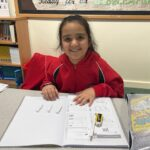 Image of a Hallfield pupil in a Maths lesson at Hallfield School.