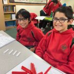 Image of Hallfield pupils in a Maths lesson at Hallfield School.