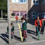 Image of Hallfield pupil in an outdoor Maths lesson at Hallfield School.