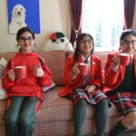 Image of Hallfield pupils holding warm drinks.