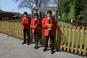Image of Hallfield pupils holding Easter eggs.