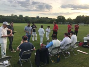 Image of the Old Hallfieldians taking a break from playing cricket.